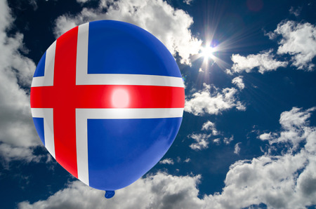 iceland flag: balloon in colors of iceland flag flying on blue sky Stock Photo