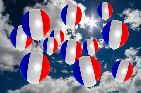 nationalistic: many ballons in colors of france flag flying on sky Stock Photo