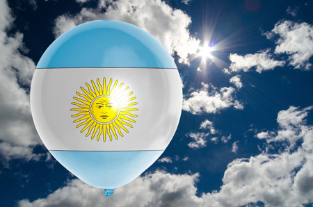 nationalistic: balloon in colors of argentina flag flying on blue sky Stock Photo