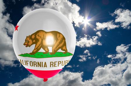 california flag: balloon in colors of california flag flying on blue sky