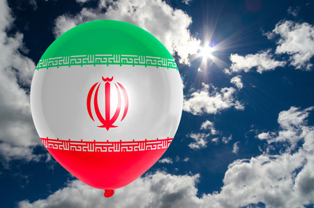 nationalistic: balloon in colors of iran flag flying on blue sky