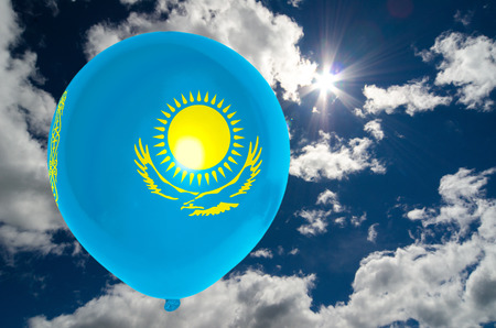 nationalistic: balloon in colors of kazakhstan flag flying on blue sky Stock Photo