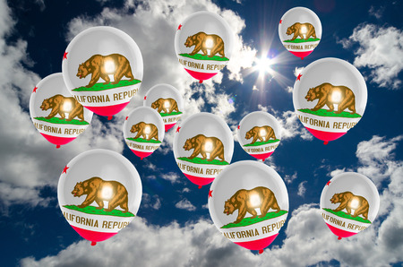 california flag: many ballons in colors of california flag flying on sky