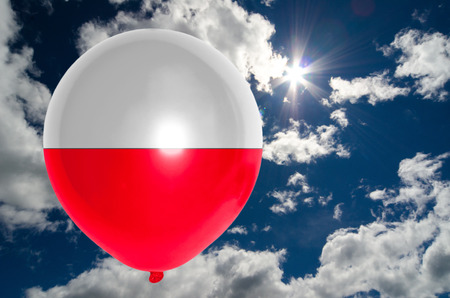 poland flag: balloon in colors of poland flag flying on blue sky