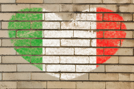 heart shaped flag in colors of Italy on brick wall photo