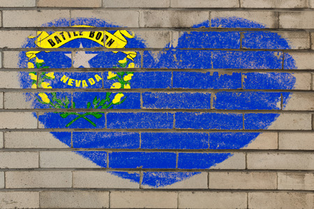 nevada: heart shaped flag in colors of nevada on brick wall