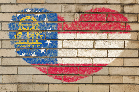 georgian: heart shaped flag in colors of georgia on brick wall