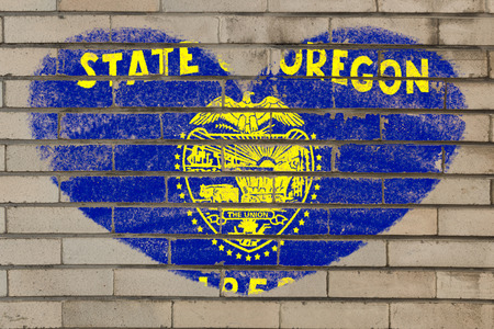 oregon: heart shaped flag in colors of oregon on brick wall