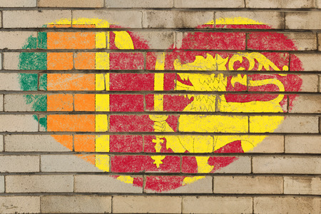srilanka: heart shaped flag in colors of sri lanka on brick wall