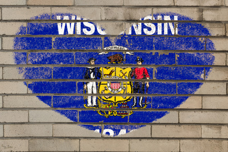 wisconsin flag: heart shaped flag in colors of wisconsin on brick wall