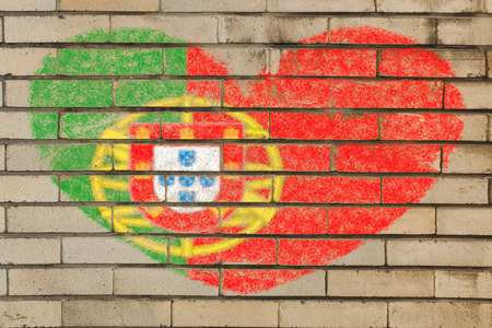 portugese: heart shaped flag in colors of Portugal on brick wall
