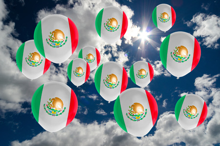 many balloons in colors of mexico flag flying on sky Stock Photo