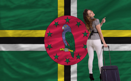 young beautiful woman is traveling to dominica
