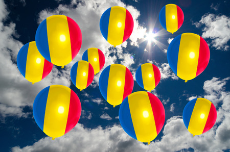 many balloons in colors of romania flag flying on sky