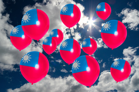 many balloons in colors of taiwan flag flying on sky