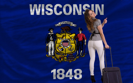 wisconsin flag: young beautiful woman is traveling to wisconsin Stock Photo