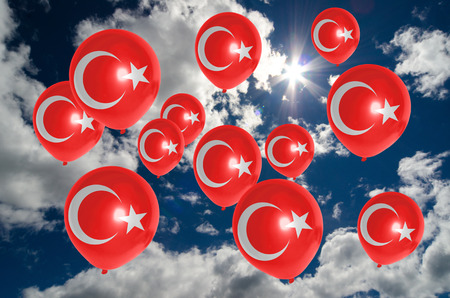 nationalistic: many balloons in colors of turkey flag flying on sky