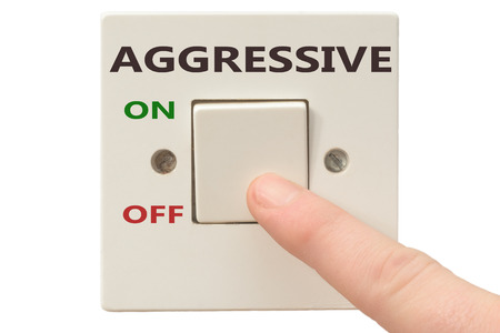 spiritual growth: Turning off Aggressive with finger on electrical switch Stock Photo