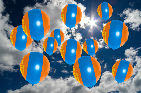 many balloons in colors of mongolia flag flying on sky Stock Photo