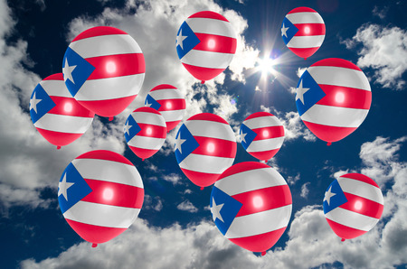 many balloons in colors of puerto rico flag flying on sky