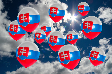 slovakia flag: many balloons in colors of slovakia flag flying on sky