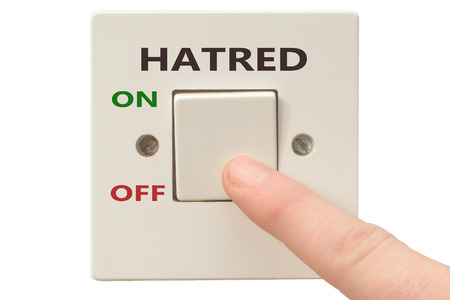 hatred: Turning off Hatred with finger on electrical switch Stock Photo