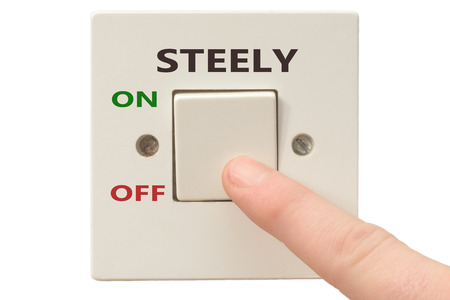 turning off: Turning off Steely with finger on electrical switch Stock Photo