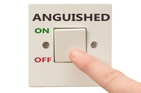 anguished: Disattivazione Angosciato con il dito sul interruttore elettrico Archivio Fotografico