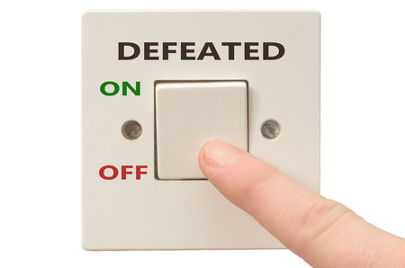 defeated: Turning off Defeated with finger on electrical switch Stock Photo