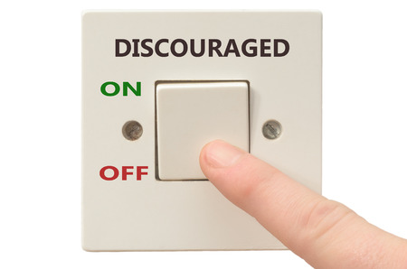 discouraged: Turning off Discouraged with finger on electrical switch Stock Photo