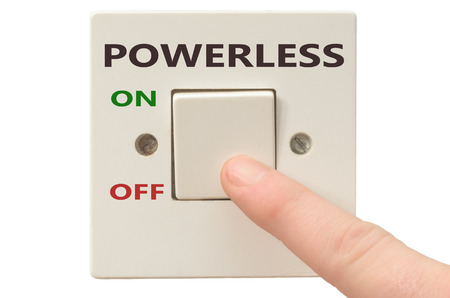 powerless: Turning off Powerless with finger on electrical switch Stock Photo