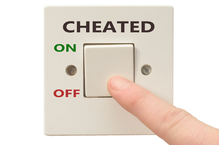 cheated: Turning off Cheated with finger on electrical switch Stock Photo