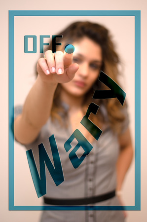 turning off: young woman turning off Wary on screen Stock Photo