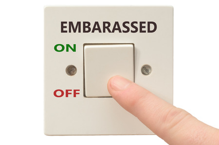 embarassed: Turning off Embarassed with finger on electrical switch Stock Photo