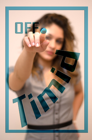 timid: young woman turning off Timid on screen