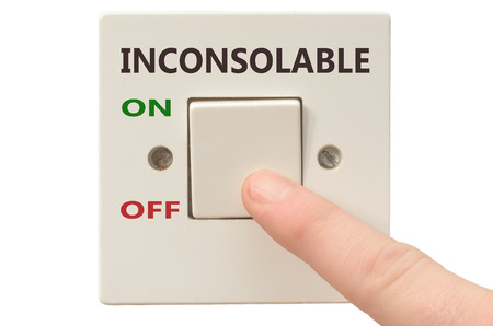inconsolable: Turning off Inconsolable with finger on electrical switch Stock Photo
