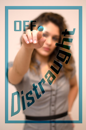 turning off: young woman turning off Distraught on hologram screen Stock Photo