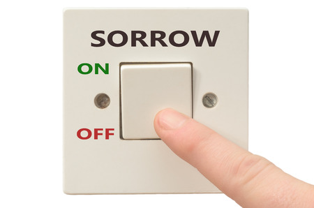 spiritual growth: Turning off Sorrow with finger on electrical switch