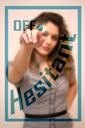 hesitant: young woman turning off Hesitant on screen Stock Photo