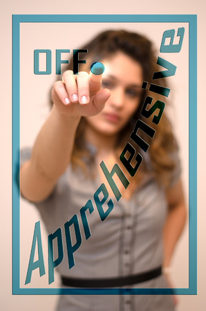 apprehensive: young woman turning off Apprehensive on screen Stock Photo