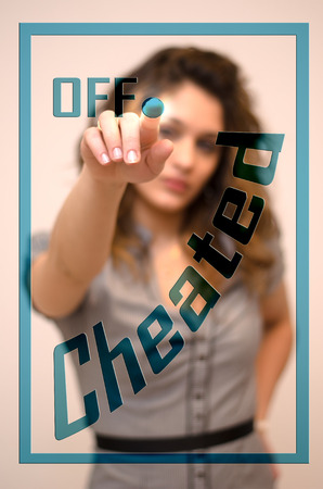 cheated: young woman turning offCheated on hologram screen Stock Photo