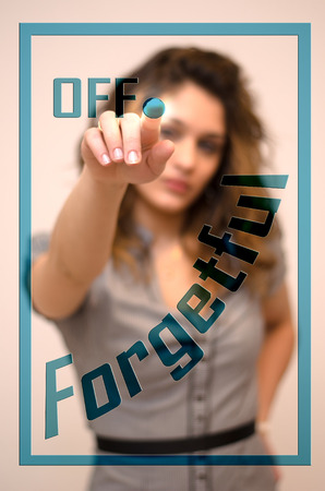 apathy: young woman turning off Forgetful on digital panel Stock Photo