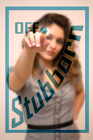 stubborn: young woman turning off Stubborn on screen