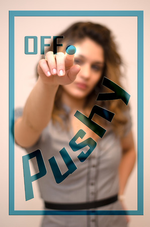 young woman turning off Pushy on screen Stock Photo