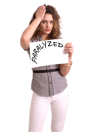 paralyzed: Young attractive woman holding paper with Paralyzed text on white background