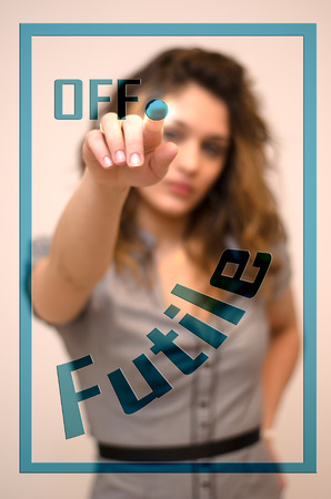 futile: young woman turning off Futile on digital panel