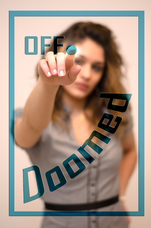 doomed: young woman turning off Doomed on digital panel Stock Photo
