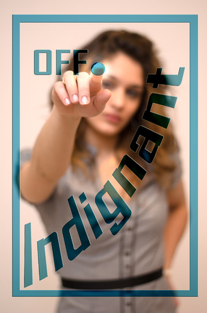 indignant: young woman turning off Indignant on screen