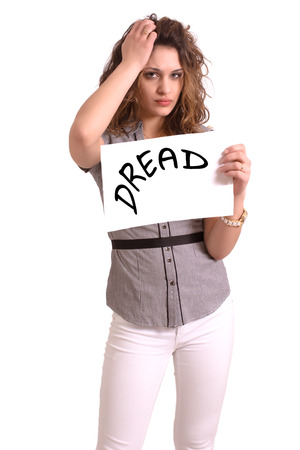 dread: Young attractive woman holding paper with Dread text on white background