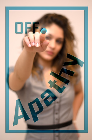 apathy: young woman turning off Apathy on digital panel Stock Photo